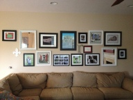 Round 1 of photo wall behind couch