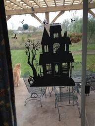 Spooky House on the back sliding glass window.