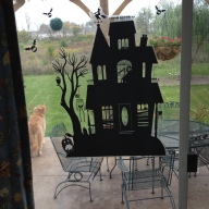 Spooky House on the back sliding glass window.